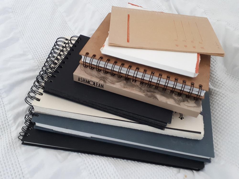 A Pile of Sketchbooks