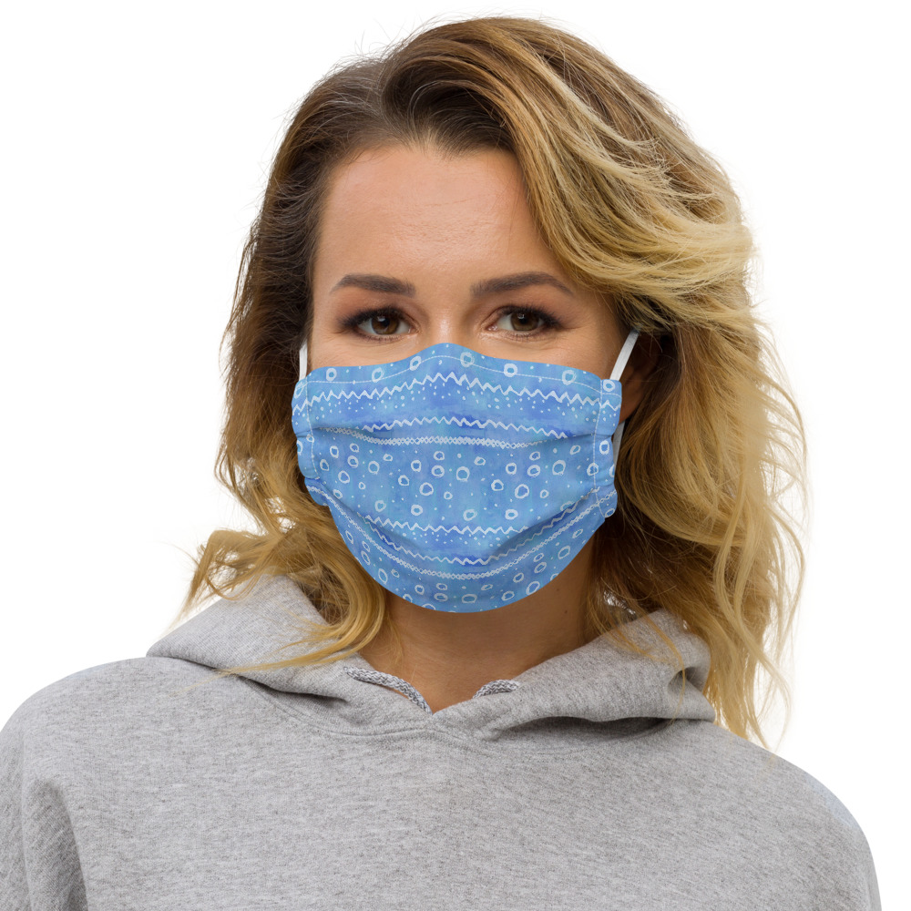 Woman wearing a blue face mask.