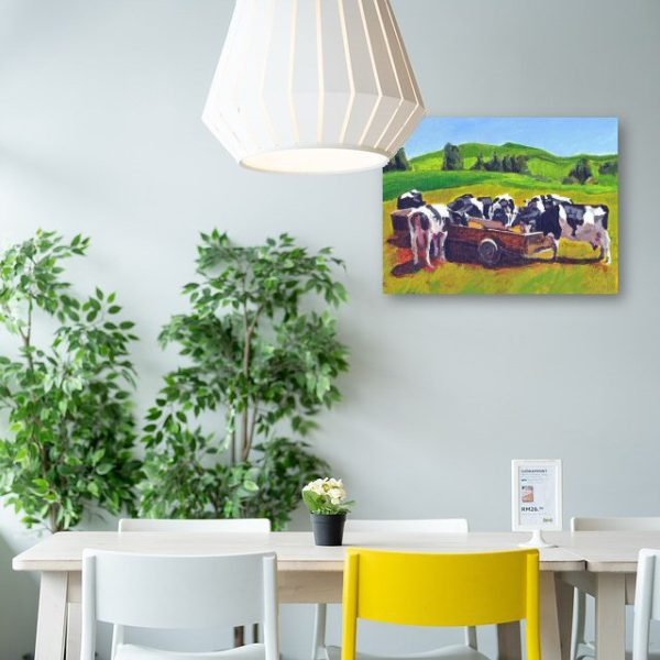 cows in field feeding canvas wall art