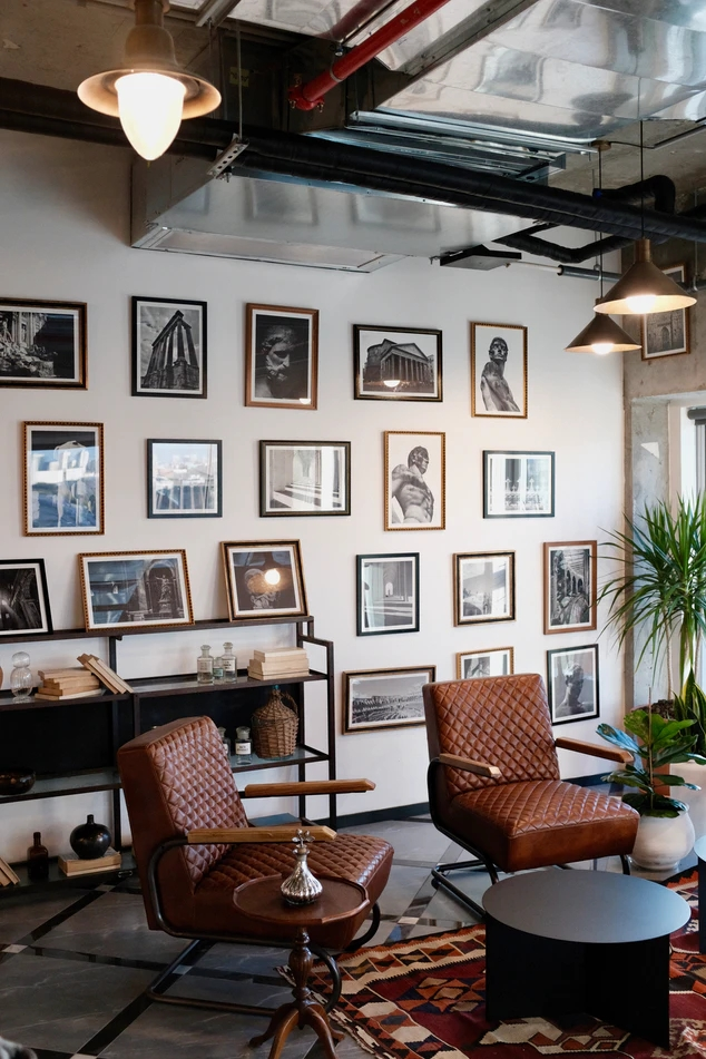 A wall of art prints in a living room
