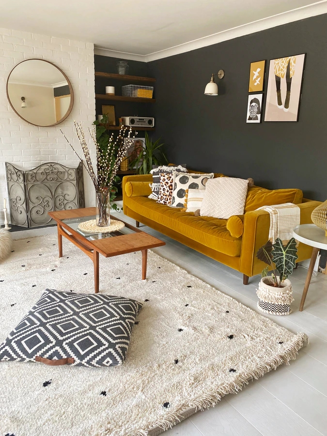 The wall art in this living room match the soft furnishings.