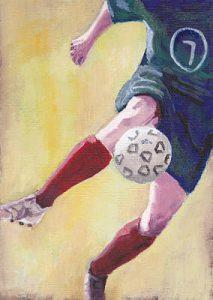 Footballer In Red Socks